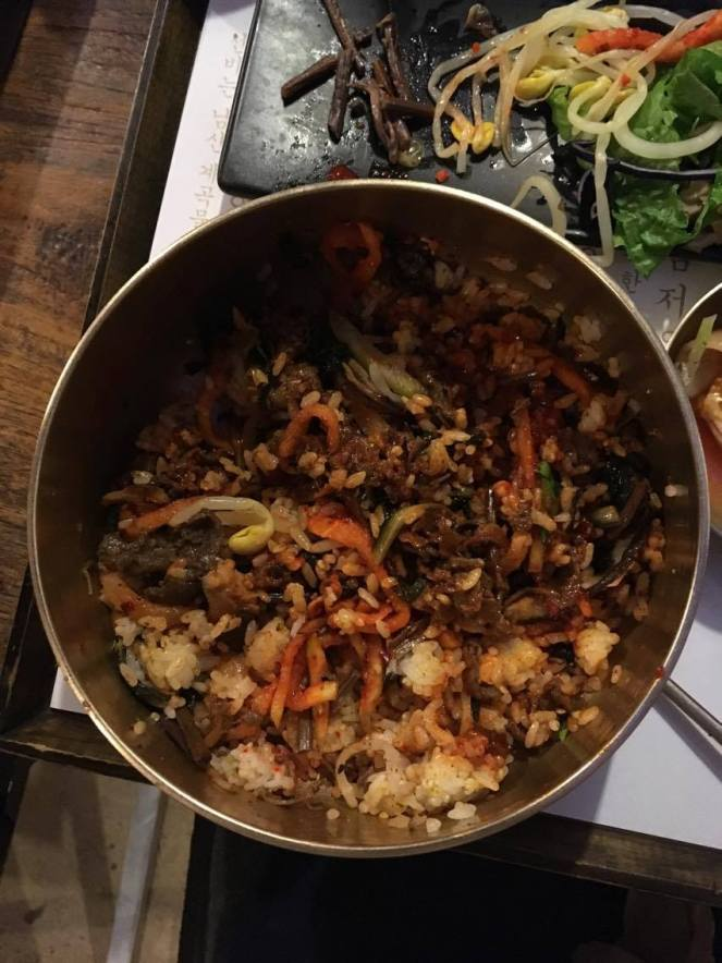 mixed bulgogi beef bibimbap in a bronze bowl at Mokmyeoksanbang, Seoul, South Korea
