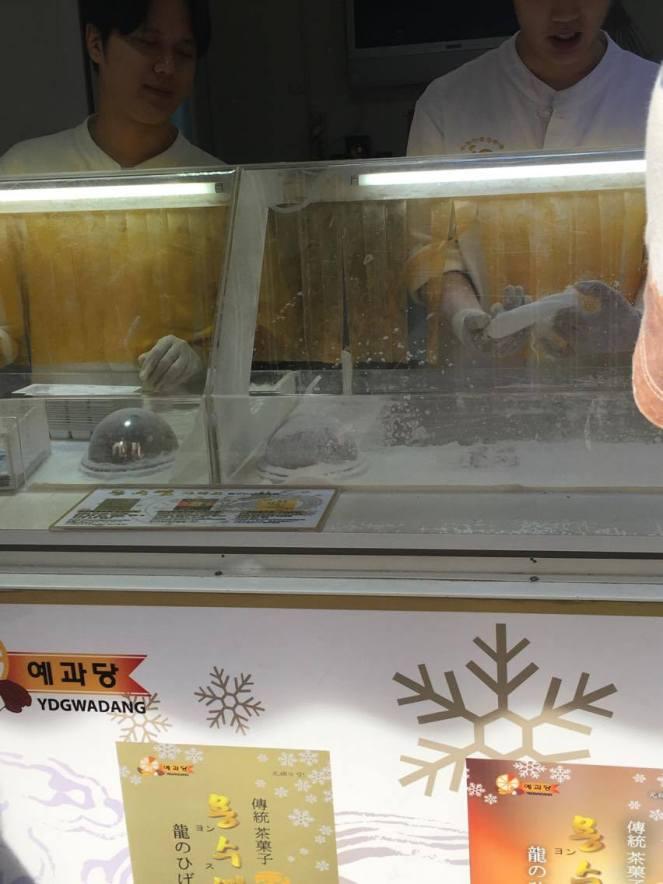 2 men working at a Kkul-tarae (Korean court cake or Dragon's beard candy) stall, Insadong, Seoul, South Korea