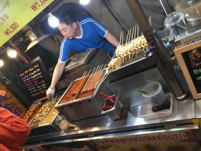 a street food stall selling meat on sticks in Seoul, South Korea