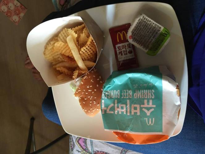 a paper box with a wrapped McDonald's shrimp beef burger, tomato ketchup sachet and fries in Seoul, South Korea
