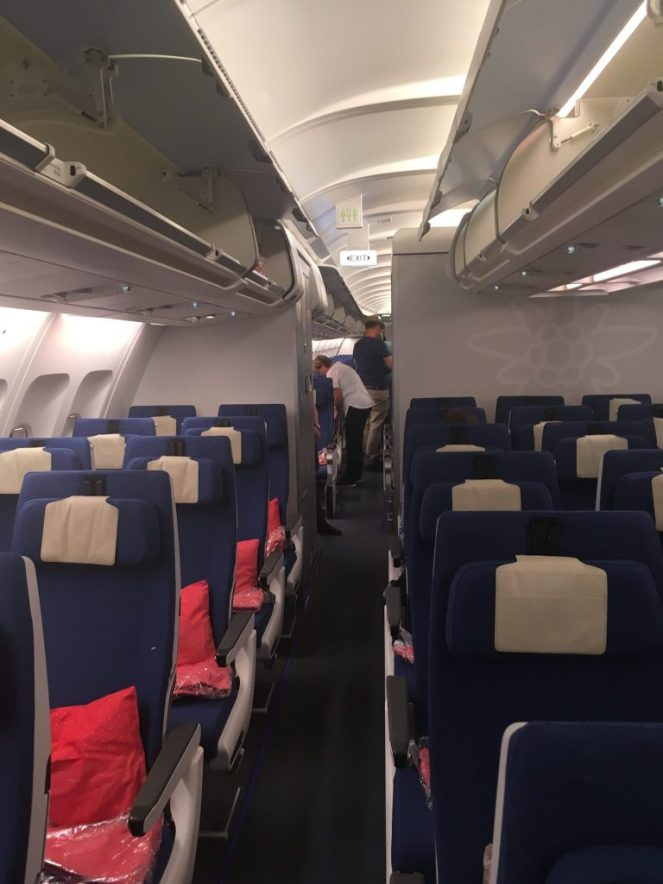 Blue economy seats on Edelweiss Air Airbus 340-300 plane