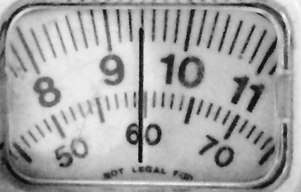 a close up of weighing scales showing pounds and kilograms