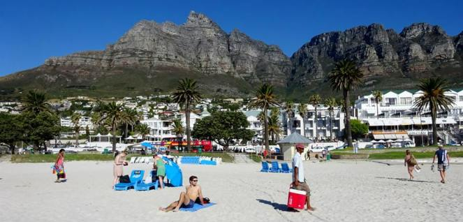 a beach with Table Mountain in the background, Cape Town, South Africa