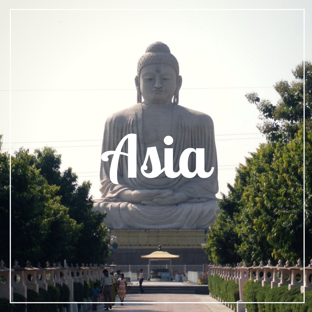 Asia written over a photo of a statue of a giant stone buddha