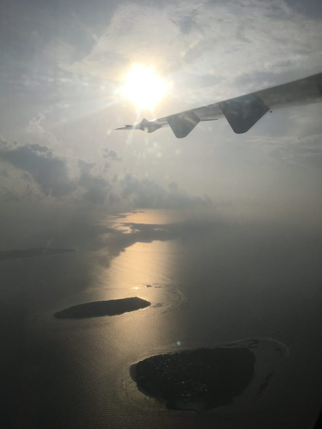 A view from a plane of the Maldives in the morning sun