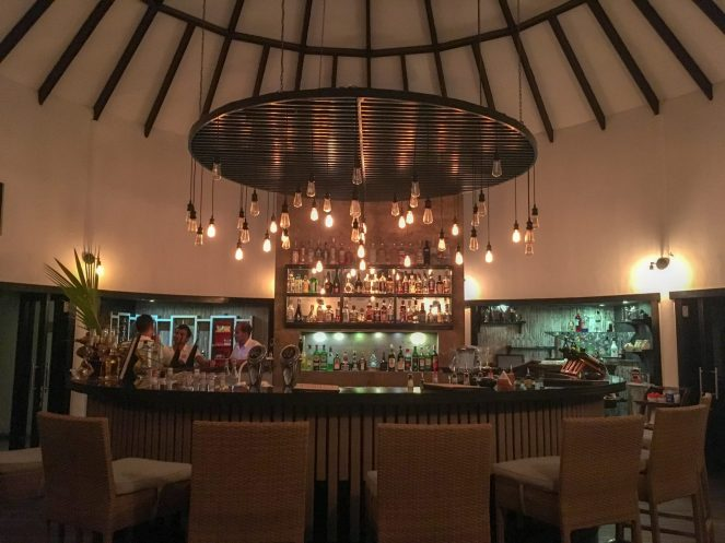 inside the Raaveriya bar at night at Kihaa Maldives