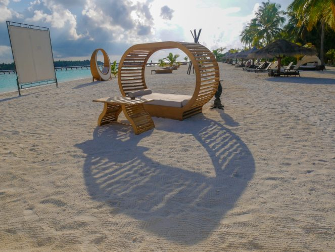 A projector screen with sun loungers on the beach at Kihaa Maldives
