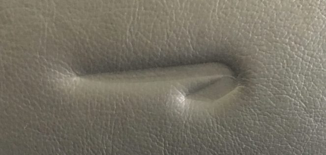 British Airways logo in a leather aeroplane seat