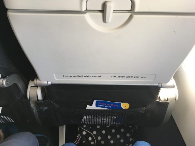Economy tray table on a British Airways Airbus A320