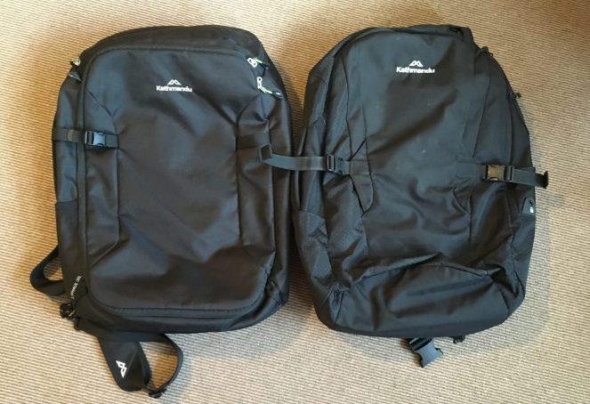 2 black backpacks Kathmandu Litehaul 38L (2018) on the left and Kathmandu Litehaul 38L V3 (2017) on the right
