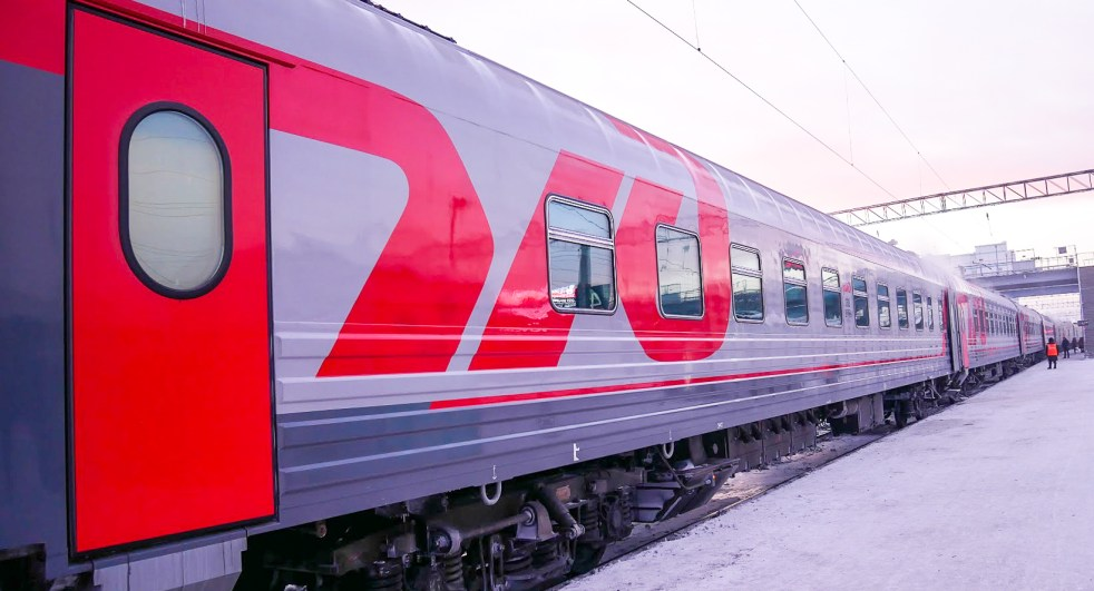 a trans-Siberian train on a platform in Russia