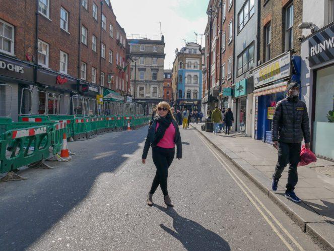 Rosie standing in Old Compton Street, Soho, London