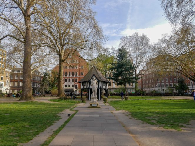 Soho Square Gardens with a statue of Charles II in front of the wooden mock market-cross building, Soho, London