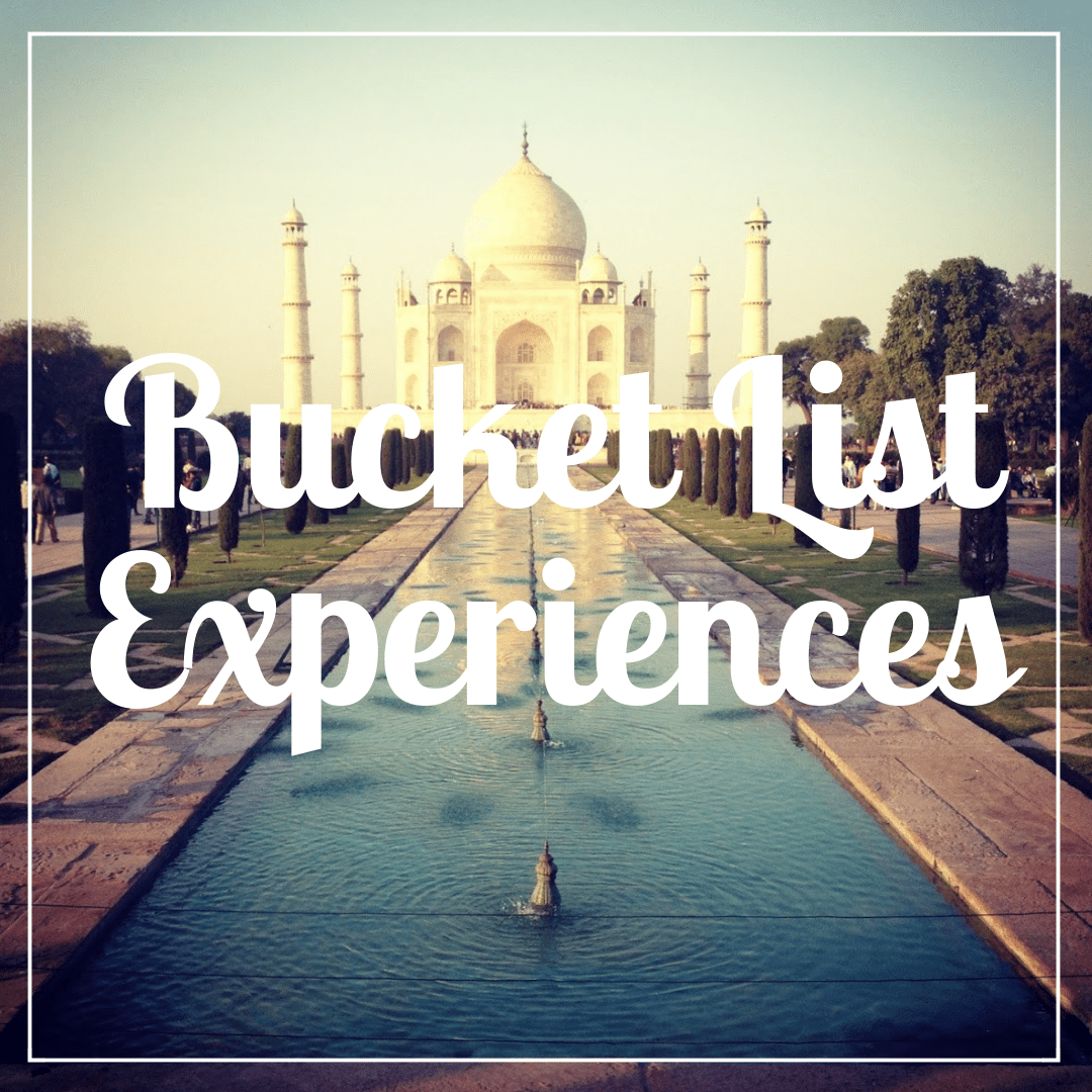 Bucket List Experiences written over a photo of the Taj Mahal