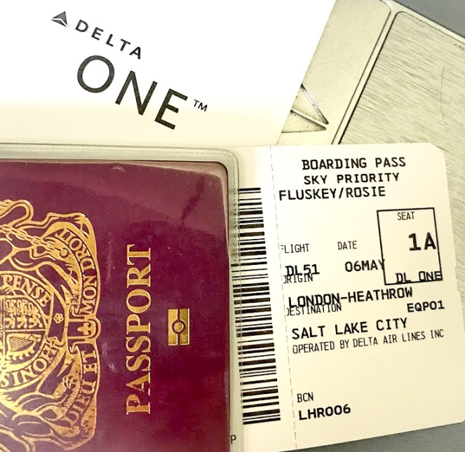 A British passport with a Sky Priority boarding pass seat 1A London Heathrow to Salt Lake City Delta One