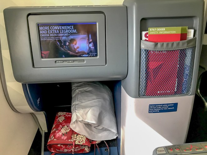 footwell, screen and safety card in Delta One on Delta Air Lines Boeing 767