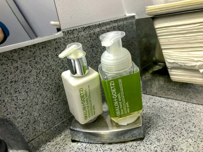 MALIN+GOETZ body lotion and hand wash in a Delta Air Lines Boeing 767 bathroom