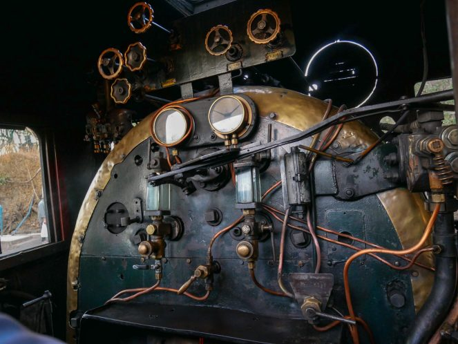 Gauges and copper pipes inside the engine cab of the Royal Livingstone Express train