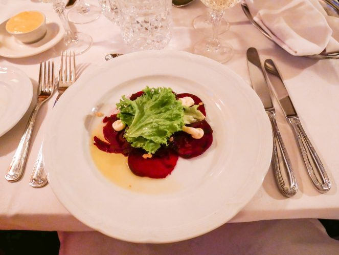 Beetroot carpaccio topped with goats cheese mousse and lettuce