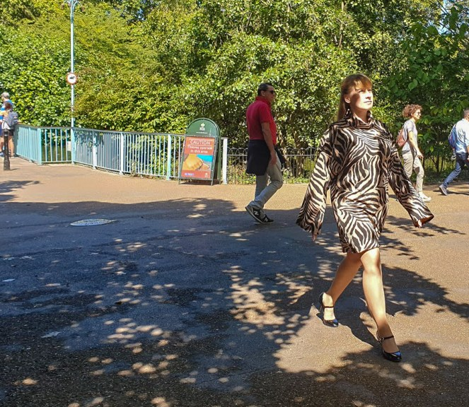 Rosie in a camel tiger print dress, walking in St James's Park