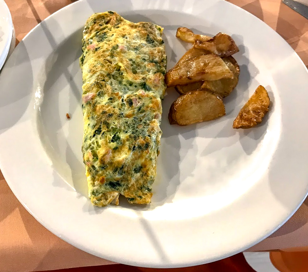 Big omelette and pile of yummy potatoes