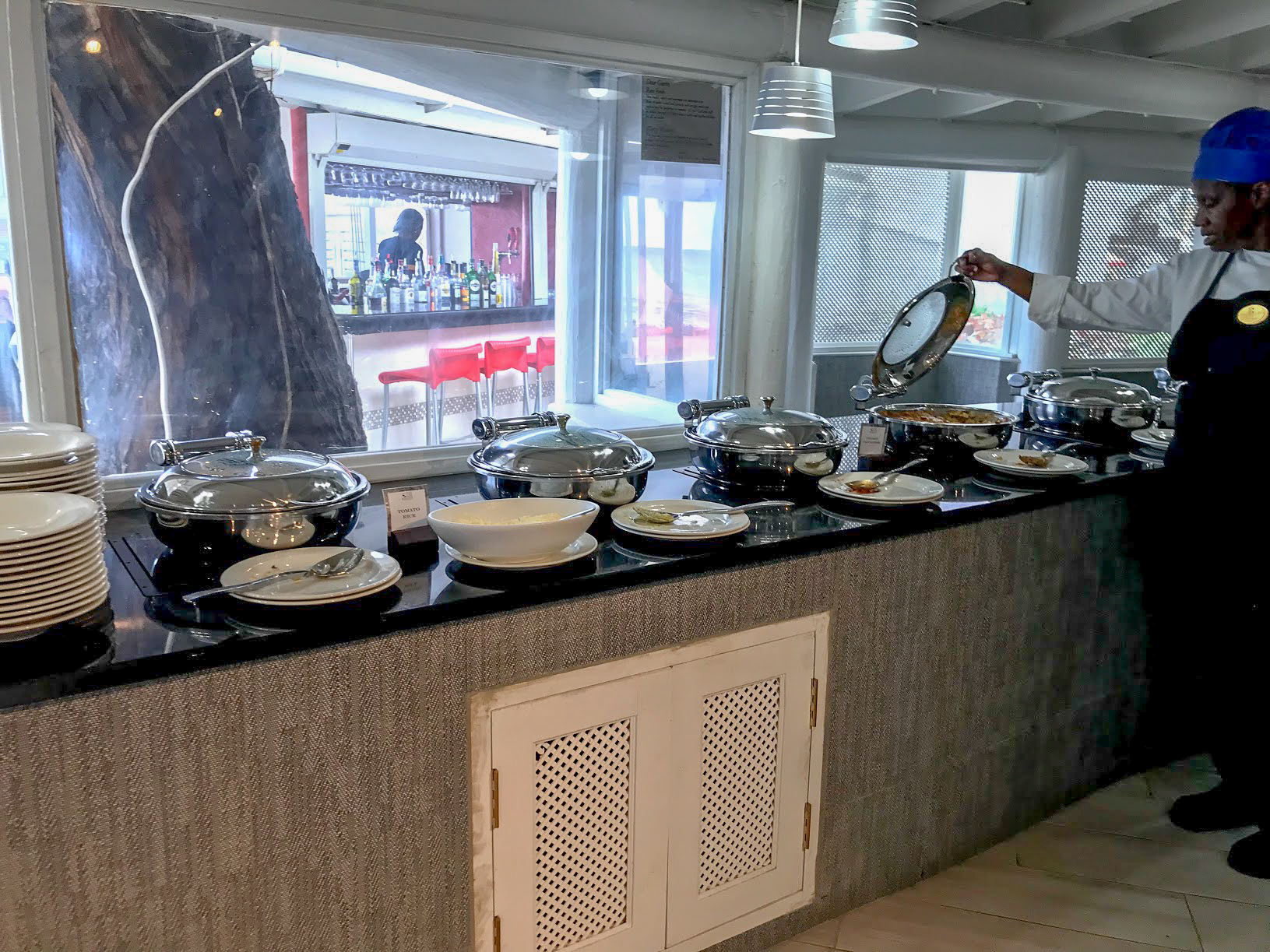 Hot buffet dishes with their lids open and shut