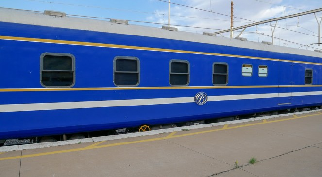 a Blue Train carriage at a station platform