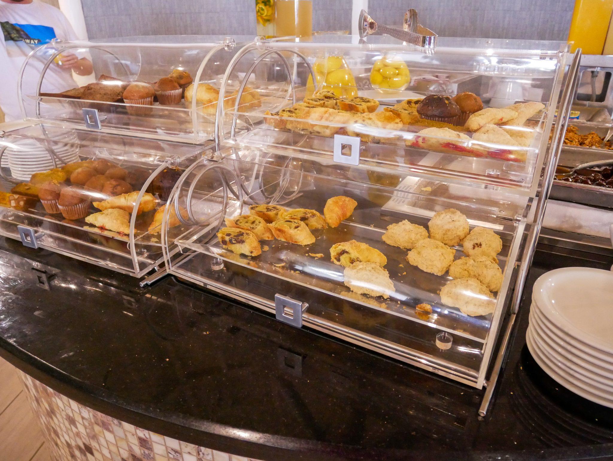 Breakfast pastries in their clear bread bins