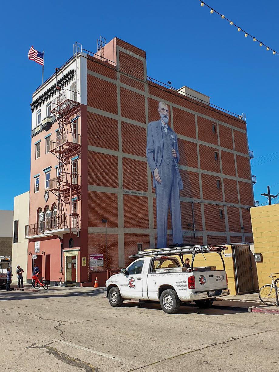 A mural on the side of a red brick building in Venice, Los Angeles