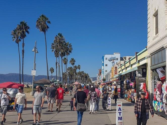 People walking along Venice Beach promenade, Los Angeles