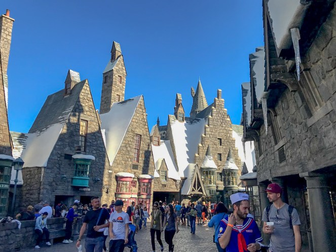 The main street of Hogsmeadepacked with people