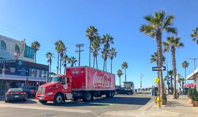 A Coca-Cola truck on a street in Venice Beach, Los Angeles
