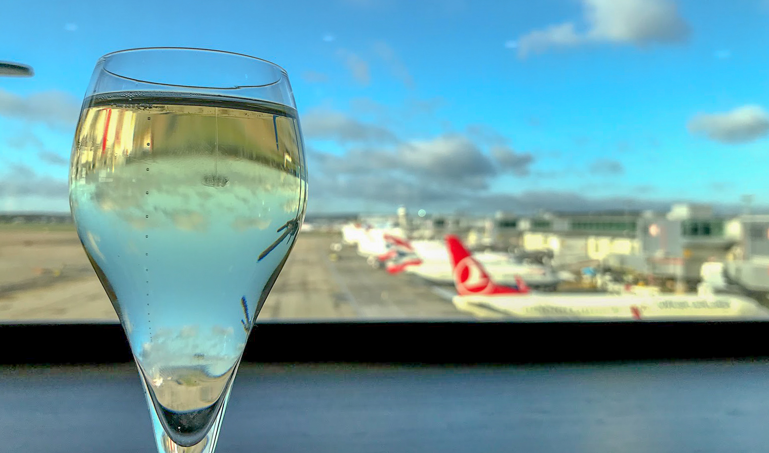 champagne by the window, overlooking planes at No1 Lounge at London Gatwick South Terminal