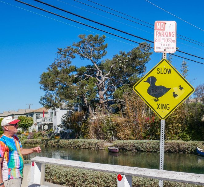 Canal with a yellow duck crossing sign on the Venice Beach Secret Food Tour