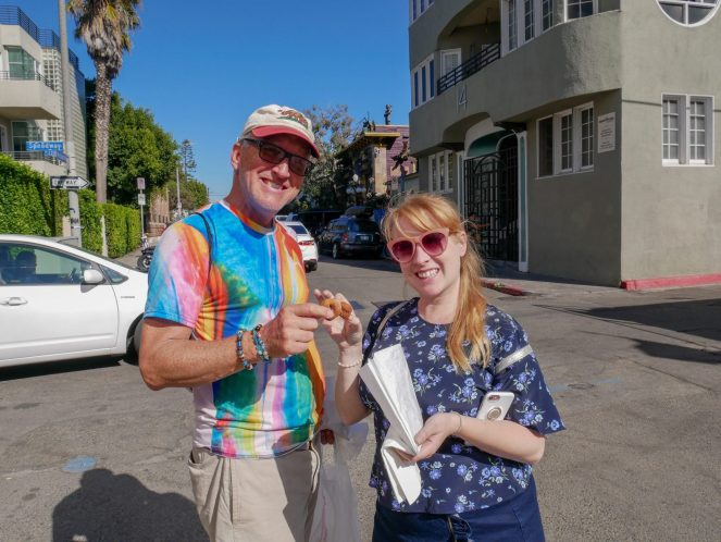 John from Venice Beach Secret Food Tour and Rosie Fluskey eating doughnuts in Venice, Los Angeles