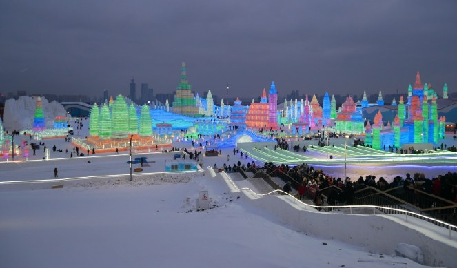 Harbin Ice & Snow Festival in the evening lit up by colourful lights, China