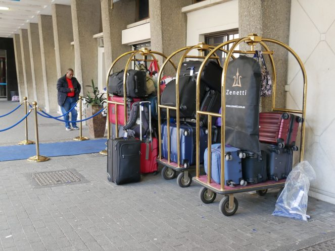 Luggage on gold trolleys outside Cape Town Blue Train Station