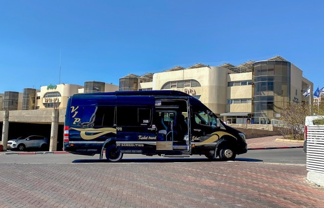 a dark blue minibus with VIP in gold writing in Eilat, Egypt