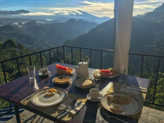 breakfast on a table at Will Guest Homestay overlooking the hills of Ella, Sri Lanka