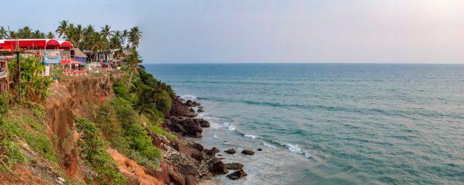 The red cliffs of Varkala beach and the Arabian Sea against the rocks, Varkala, Kerala, India