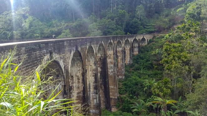 a view across the brick Nine Arches Railway Bridge, Demodara, Sri Lanka