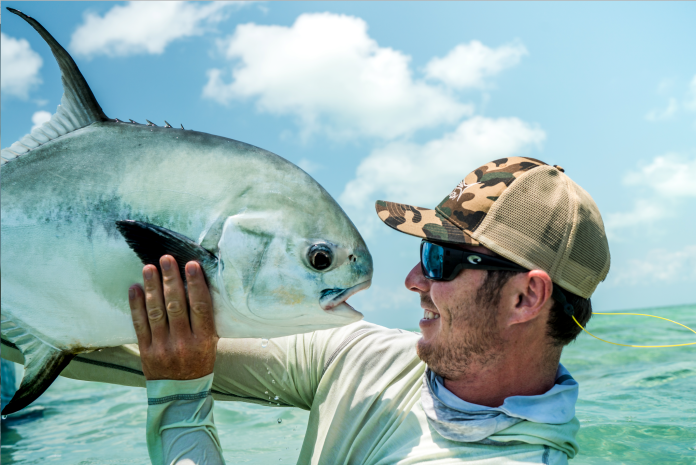 Kissing a permit fish