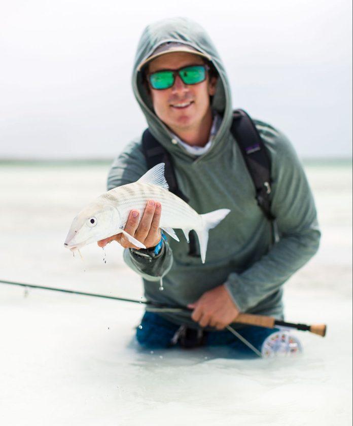 man holding bonefish