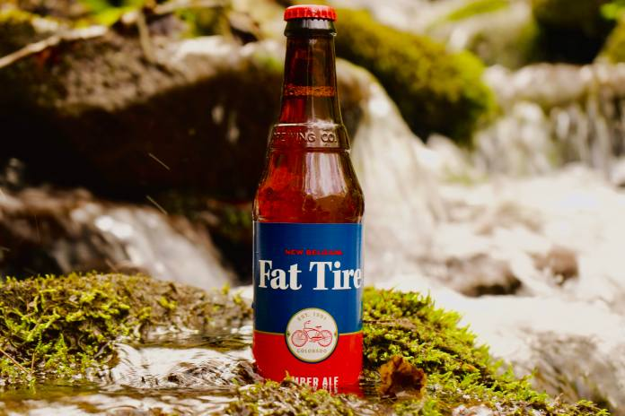 Fat Tire beer sitting in a creek