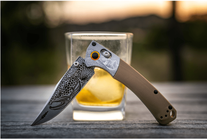 brown trout knife infront of whiskey