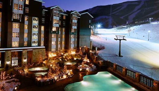 You can sit in the jacuzzi while watching your friends ski by!