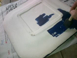 To finish off your masterpiece paint the rest of your plate with craft paint that will match some of the tiles.