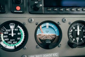 Airplane avionic panel and compasses