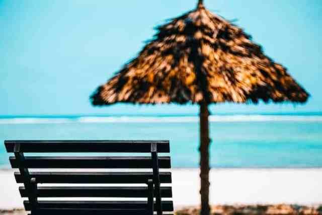 Beach lounge chair and umbrella on beach in Bali   Bali Beach Club