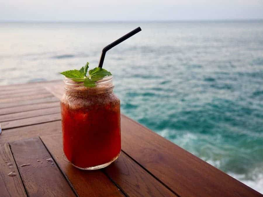 Refreshing cocktail overlooking an ocean beach in Bali
